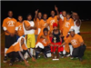 Football team wearing orange shirts pose with trophy