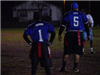 Two football players wait to play